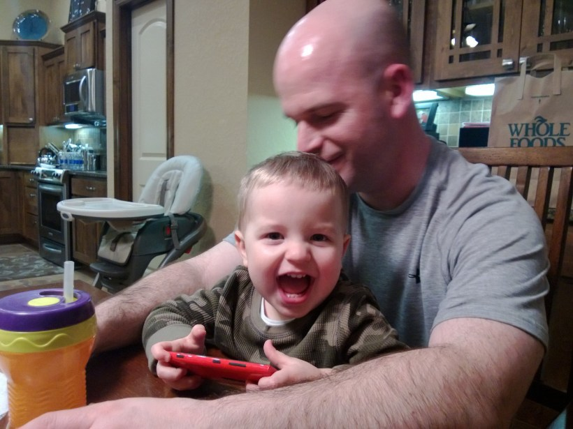 A grand smile resulting from Daddy kisses!