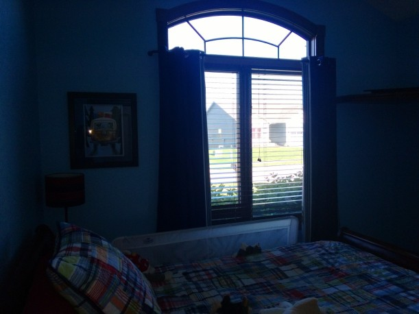 This is a terrible picture, but here are the curtains and print hung up!  Those curtains to block the light well!