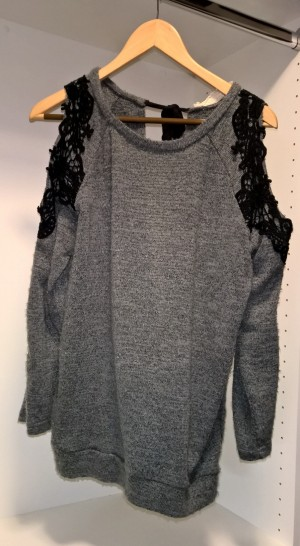 I love this sweater - it is so fun to wear!  It has a tie neck in the back and it's open in the back